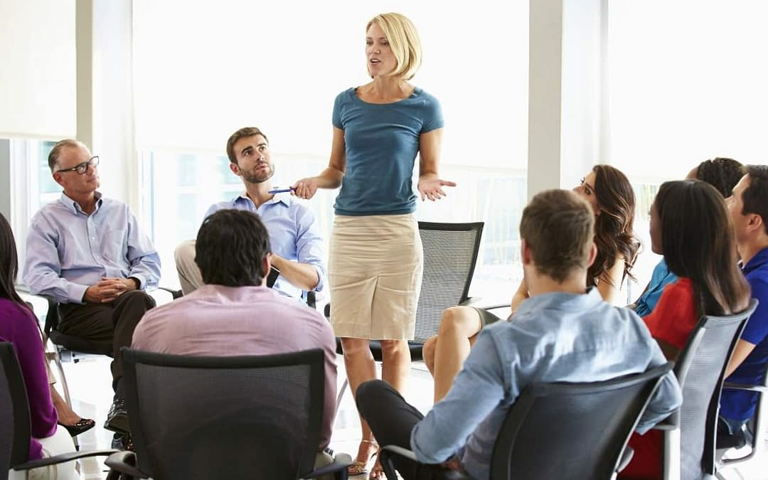 Woman presenting to a Business Group